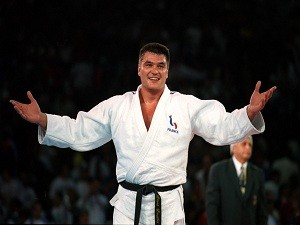 France's David Douillet is all smiles after winning the gold medal in the Men's +100kg category